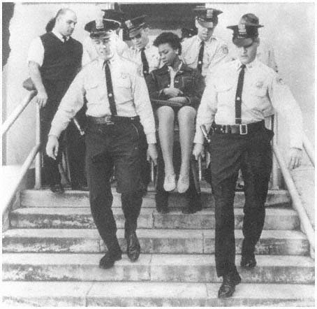 Doris Jean Castle, CORE MEMBER, removed from City Hall in 1963 demonstration after refusing to leave council chamber. Courtesy New Orleans Ti.jpg